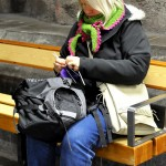 lady knitting in Stockholm Tunnelbana